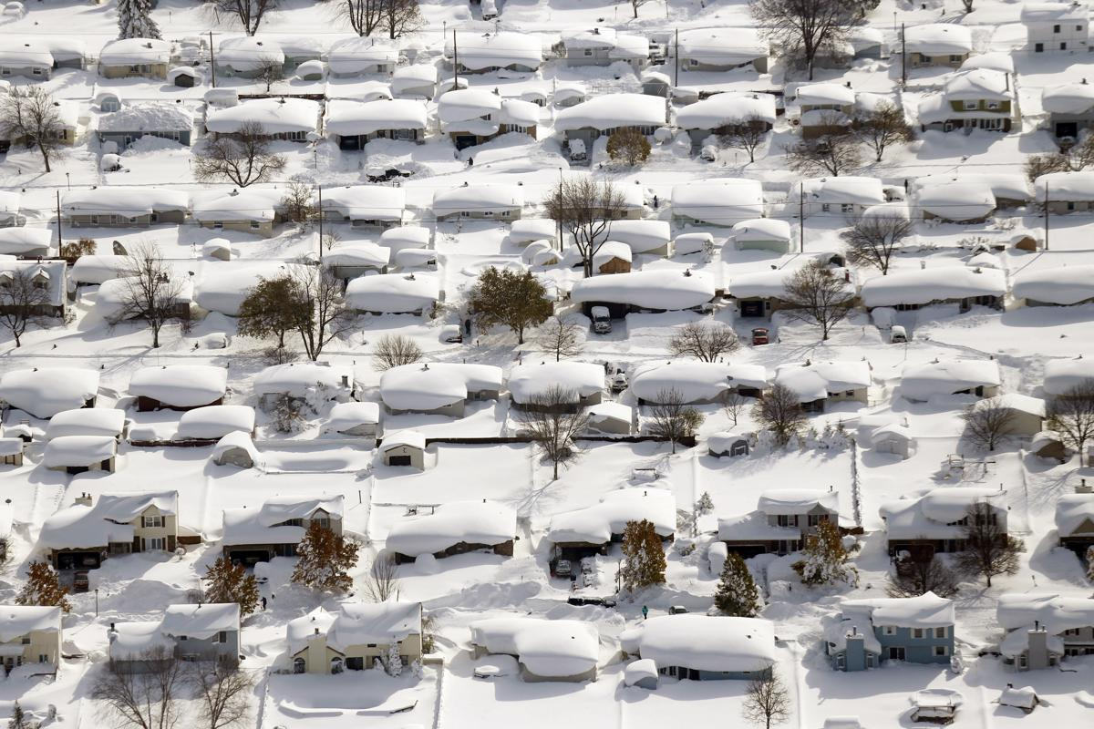 E Buffalo News Snow buries area in up...