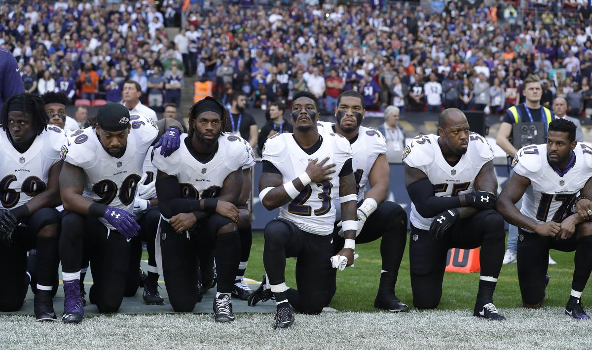 Some Ravens players take a knee before facing the Jaguars in London.
