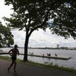 Runners and sunbathers at the Esplanade at the Charles River take advantage of the summer temperatures.
