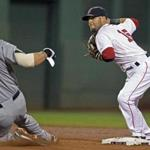 Dustin Pedroia of the Red Sox pulls a triple play