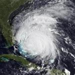 Handout image courtesy of NOAA shows a visible view of Hurricane Irene captured by the GOES-East satellite yesterday.