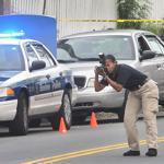 Police photographed the scene where two teenagers were shot on Geneva Avenue in Dorchester. One teen died and the other has injuries considered life threatening, police said.