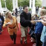 Republican presidential candidate Mitt Romney and his wife, Ann, arrived Saturday at the Republican Leadership Conference at the Grand Hotel on Mackinac Island, Mich.
