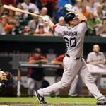 Red Sox catcher Ryan Lavarnway follows through on his first big league home run, a three-run blast that put Boston ahead, 5-1.