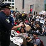 Police negotiating with a group of students who briefly blocked Atlantic Avenue this afternoon.
