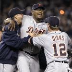 Jose Valverde, center, celebrates with teammates, including Andy Dirks, right, after the Tigers beat the New York Yankees 3-2 in to win baseball's American League division series.