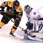 Lightning goalie Mathieu Garon  makes a save on this shot by Bruins left wing Brad Marchand during the first period.