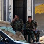 Syrian soldiers manned a checkpoint in Rastan Thursday.