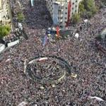 A photo taken from a helicopter shows supporters of Syrian President Bashar al-Assad's gathering during a rally at al-Sabaa Bahrat square in Damascus October 12, 2011. Tens of thousands of Syrians demonstrated in central Damascus on Wednesday in show of support for al-Assad, who is battling a six-month uprising against his rule in which the United Nations says 2,900 people have been killed. REUTERS/Wael Hmidan (SYRIA - Tags: POLITICS)