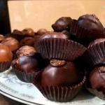Delectable truffles await in glass cases at Laughing Moon Chocolates in Stowe, Vt.