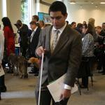 Melody, a guide dog, accompanied one of the job seekers to the Grousbeck Center's jobs fair yesterday. Nearly 100 visually impaired people attended the event.
