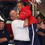 Boston Fire Lieutenant Glenn McGillivray hoisted Xavier Lara yesterday, two days after the 6-year-old's grandmother dropped him into McGillivray's arms from the third-floor window of their burning home in Roxbury. The badly burned suspect in the blaze pleaded not guilty yesterday from his bed at Massachusetts General Hospital.