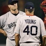 Boston Red Sox pitching coach Curt Young, left, has returned to the Oakland Athletics after an unsuccessful year in Boston.