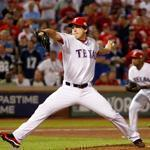 Derek Holland allowed two hits over 8 1-3 innings in the Rangers' victory over the Cardinals.