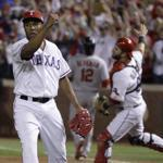 Rangers reliever Neftali Feliz and catcher Mike Napoli are pumped after the Cardinals' Lance Berkman is out at first to end Texas' victory in Game 5.