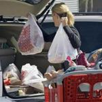 A woman loaded purchases from a Target store into her car in Culver City, Calif.