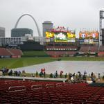 A tarp covers the infield at Bush Stadium after Major League Baseball cancelled Game 6 of the World Series due to poor weather in St. Louis, Missouri, October 26, 2011. REUTERS/Sarah Conard (UNITED STATES - Tags: SPORT BASEBALL)