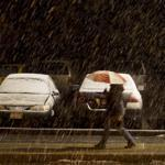 FOR METRO. Fitchburg, MA 10/27/2011 A pedestrian walks along North St. near Fitchburg State University, as snow starts to gather on parked cars in the early evening in Fitchburg, MA on Thursday, October 27, 2011. (Yoon S. Byun/Globe Staff) Section: METRO Slug: n/a Reporter: n/a LOID: 5.0.426299454