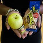 Roxbury, MA -- 10/28/11 -- Brandy K. Cruthird displays a basket of the healthy alternatives that she is offering kids for Halloween as she stands inside Body by Brandy 4 Kidz, in Roxbury, MA. (Kayana Szymczak for The Boston Globe)