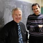 BU physicist H. Eugene Stanley (left) and Boris Podobnik, a visiting scholar, proposed a new model to understand credit rating changes.
