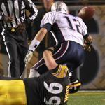 Wrapped up by the Steelers' Brett Keisel late in the fourth quarter, Patriots quarterback Tom Brady fumbles into the end zone for a safety.