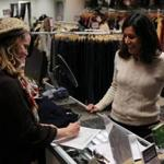 "Kim Tindell (left), store manager of Second Time Around, and Globe reporter Beth Teitell. ""People are very attached to their garments,'' Tindell said."