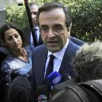 Leader of the Greek main opposition party, Antonis Samaras (C) talks to reporters after his meeting with Greece's president in Athens on November 6, 2011. A breakthrough in Greece's damaging political stalemate seemed increasingly likely today as the opposition leader said a deal on a unity government was possible if Prime Minister George Papandreou resigns. Amid dire warnings that the country is about to run out of cash and growing anger at the squabbling, Antonis Samaras said the debt-wracked country had to give a message of stability to the outside world. AFP PHOTO / LOUISA GOULIAMAKI (Photo credit should read LOUISA GOULIAMAKI/AFP/Getty Images)
