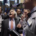Traders laughed as they worked the floor of the New York Stock Exchange today.