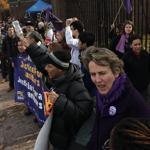 Cambridge, MA 111211 Mary Kay Henry (cq) (foreground :purple top under dk coat short hair), the International President of the Service Employees International Union (SEIU), was among the close to 200 hundred janitors, organizers, students and supporters marched around Harvard Yard on Saturday November 12, 2011 to stand up for full-time, work, affordable health care, and equality between direct and contracted out employees for the janitors who clean Harvard University. (Essdras M Suarez/ Globe Staff)/ MET