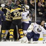 Members of the Bruins and Sabres scuffled after Milan Lucic collided with goalie Ryan Miller, right, on Saturday.