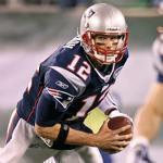 Tom Brady escapes the grasp of the Jets' Jamal Washington in the second quarer.
