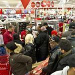 Shoppers crowded the electronics section of Target at South Bay Center in Dorchester after a 4 a.m. opening on Black Friday last year.