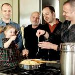 The de Magistris family – here, Filippo and his daughter Giovanna, patriarch Leon, Damian, and Dante – spends lots of time in the well-equipped kitchen.