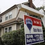 "A ""for sale"" sign hung in front of a home, in Milton, Mass. in this 2011 file photo."