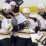 Bruins defenseman Andrew Ference, center, celebrated with the team after scoring in first period.