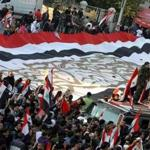 Syrian regime supporters waved their national flag as they took part in a pro-government protest in Damascus today.