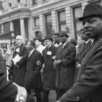 Center (from left): Dr. Benjamin Spock, Martin Luther King Jr., Monsignor Charles Rice, and Cleveland Robinson march arm in arm during an antiwar demonstration in New York on April 17, 1967.