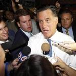 Republican candidate for U.S. president and former Gov. Mitt Romney speaks with reporters at a campaign appearance at Conchita Foods Inc. in Miami, Florida November 29, 2011. Romney received endorsements from three influential Cuban-American Republicans in a move aimed at boosting his support among conservatives and Hispanic voters. REUTERS/Joe Skipper (UNITED STATES - Tags: POLITICS ELECTIONS)