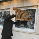 Iranian protesters broke the windows of a British Embassy building, in Tehran, Iran, today.