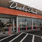 Franchisees Victor and Octavio Carvalho went retro when remodeling the Dunkin' Donuts on Southern Artery in Quincy — the chain's original restaurant — giving it a look and feel reminiscent of what it had when it opened in 1950, including a script outdoor sign and counter with stools.