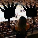 Caroline Brady, 9, of Concord showed off her bear claws during the Bruins-Red Wings game on Nov. 25.