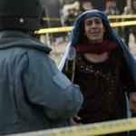 An Afghan woman mourned after a suicide bomber struck a crowd of Shi'ite worshippers at a mosque in Kabul.