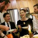 From left: James Reed, Christopher Muther, Jessica Shires, and Oliver Sellers-Garcia dipped into the cheese fondue at Muther's home for a '60s dinner party.