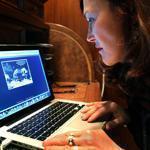 Marushka Glissen of Newton perused e-cards on her laptop.