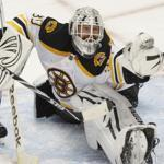 Bruins goalie Tim Thomas reaches into his bag of tricks and makes a second-period glove stop, one of his 45 saves against the Penguins.