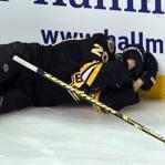 Boston, Mass. -12/08/11- .Bruins vs Florida Panthers- Boston Bruins Daniel Paille holds his head after a check by Panthers Krystofer Barch in the 1st period. He needed help off the ice. Globe staff photo by John Tlumacki (sports)