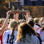 The Watertown Raiders hold their trophy aloft as they react to their 3-1 victory over Oakmont in the Div. 2 field hockey state final at Worcester State University on Saturday, Nov. 19, 2011.