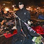 Police started tearing down the remaining tents on Dewey Square before dawn, and the cleanup continued into the morning.