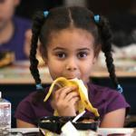 Jennifer Frias and other Perkins first-graders must eat lunch at their desks.