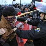 Police pushed back protesters during an Occupy movement attempt to shut down the port in Long Beach, Calif., yesterday.